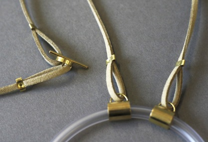 Large Motion necklace details - brass, tubing, leather and steel ball bearings