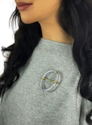 Motion knitwear brooch - brass, tubing and steel ball bearings